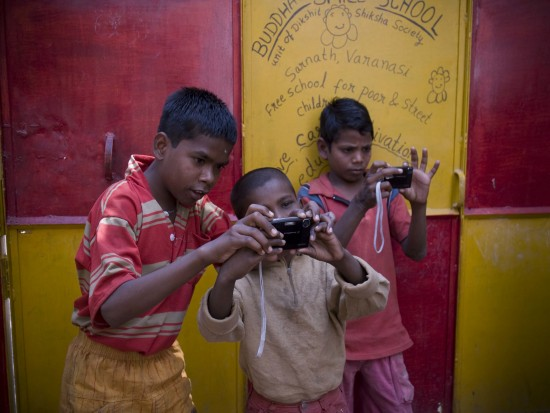pankaj-showing-the-younger-kids-how-to-use-the-cameras.preview